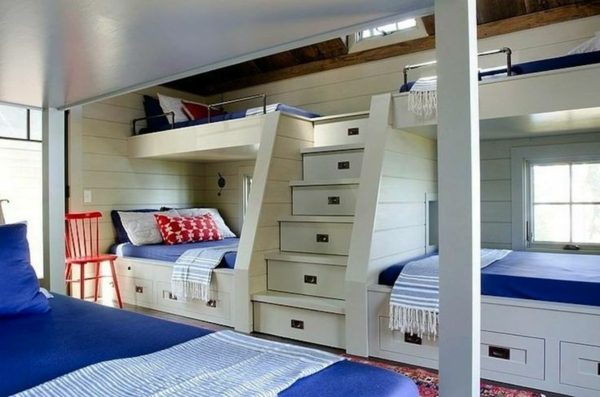 symmetrical nursery design 3 beds staircase drawers