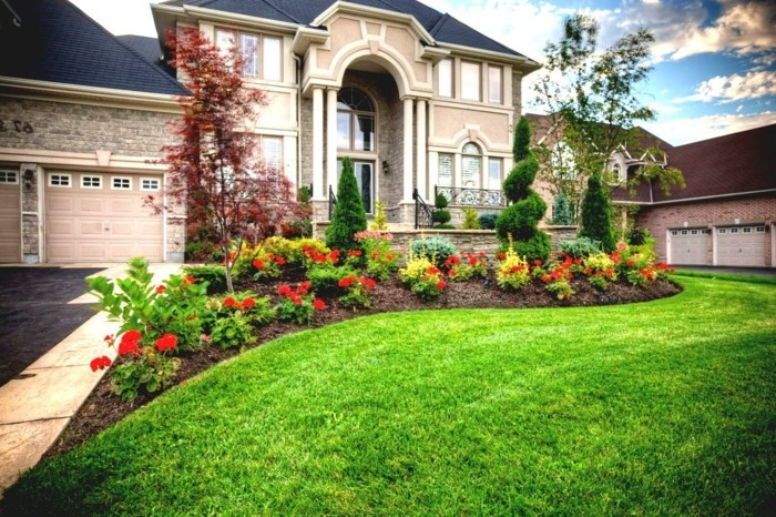 garden design beautiful flowers and green lawn