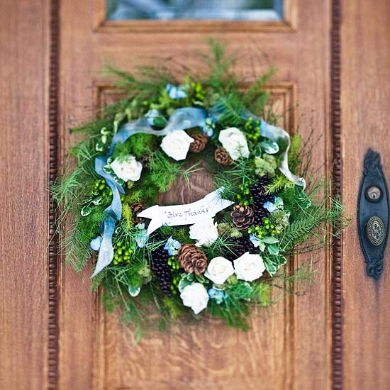 Christmas decoration wreath entrance area pinecone