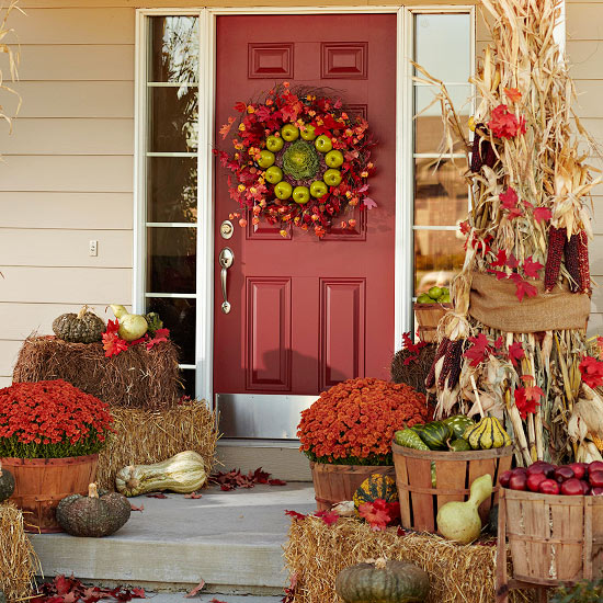 beautiful fall decoration of apple gourds and corn straw