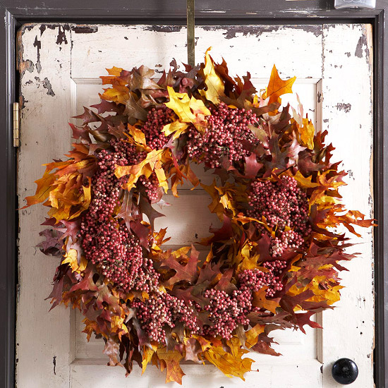 beautiful autumn decoration old door wreath of berries and leaves