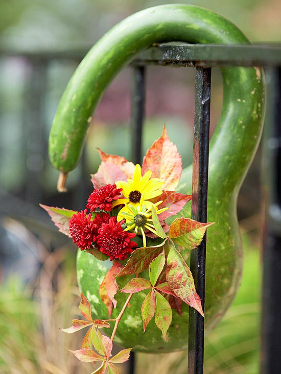 beautiful fall decoration bottle gourd vase on stair railing