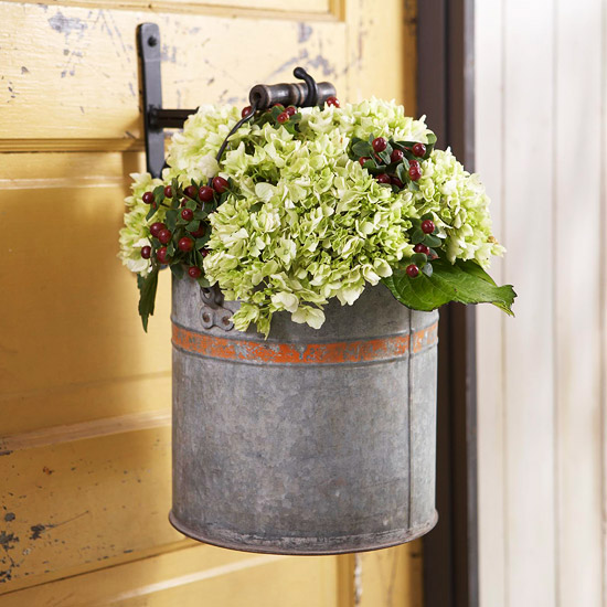 beautiful autumn decoration hanging plant container with hydrangea and berries