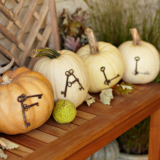 beautiful autumn decoration pumpkins decorated with letters from old keys