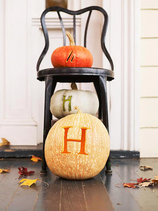 beautiful autumn decoration pumpkins with carved letters