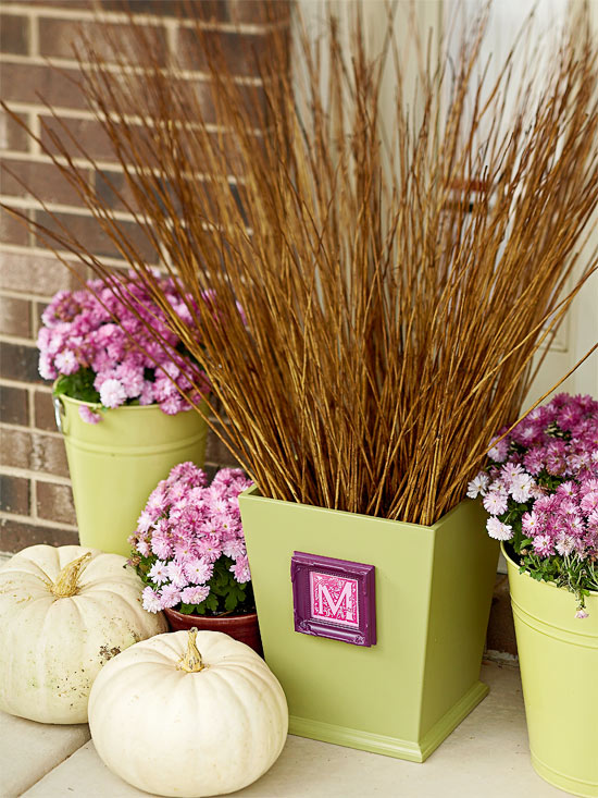 beautiful fall decoration of pink chrysanthemums and halme