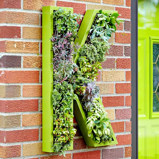beautiful autumn decoration vertical garden in a wooden letter